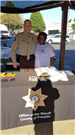 Man and Woman Working at a Sheriff County Booth